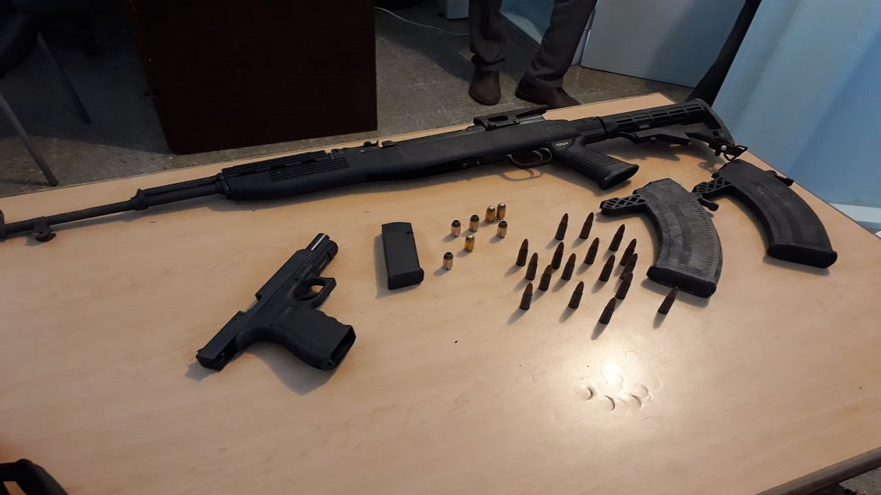 The AK-47 assault rifle with accompanying magazines, along with a Glock 9mm pistol, which were seized by the security forces in the 'Rifle Lane' area of Flanker, Montego Bay, St James on Monday morning.