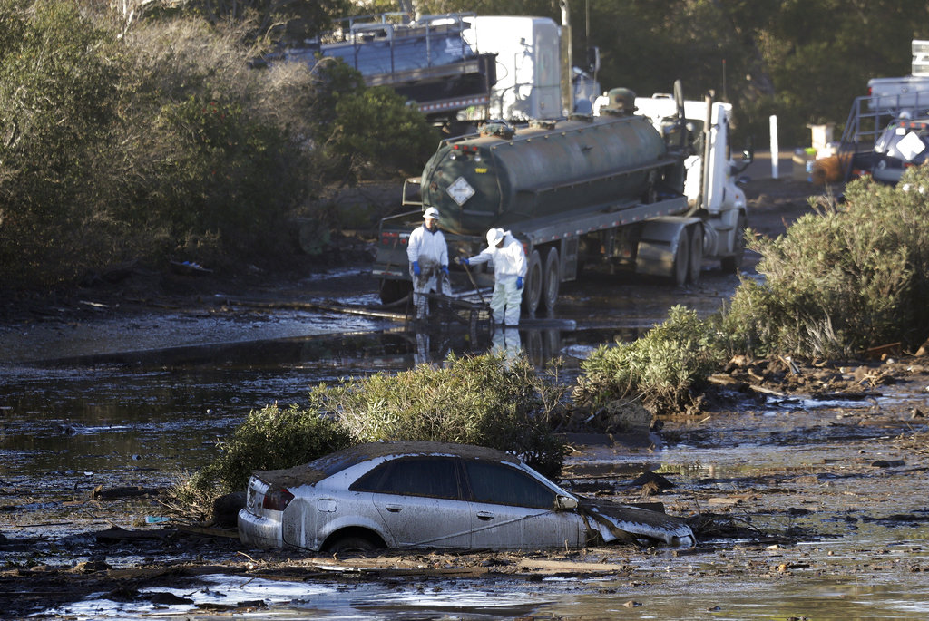 Crews pump mud on Highway 101 after a mudslide in Montecito, California. (AP Photo/Marcio Jose Sanchez)