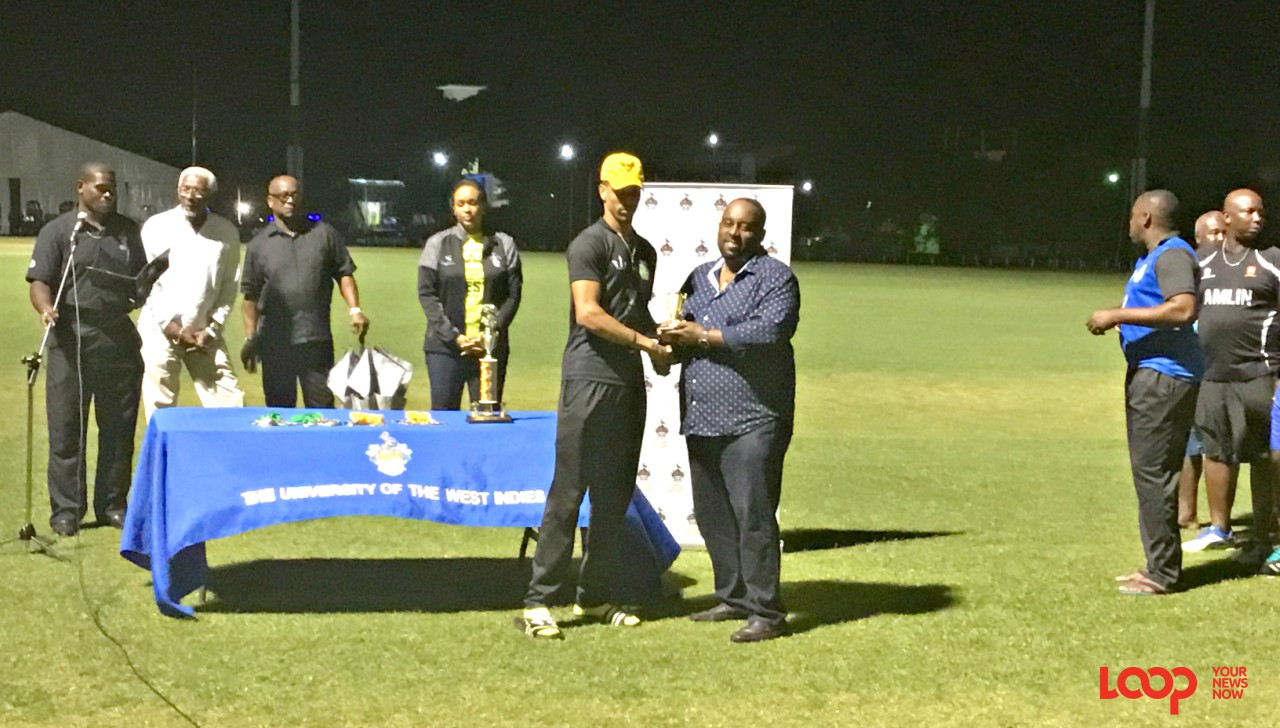 UWI Blackbirds Captain Nicholas Kirton receiving the Man of the Match award on behalf of Jonathan Carter from the Director of Cricket, BCA, Stephen Leslie.