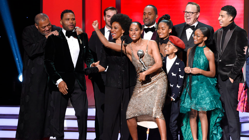 "The cast and crew of ""black-ish"" accepts the award for outstanding comedy series at the 49th annual NAACP Image Awards at the Pasadena Civic Auditorium on Monday, Jan. 15, 2018, in Pasadena, Calif. Pictured from left are Laurence Fishburne, Anthony Anderson, Jeff Mecham, Jenifer Lewis, Tracee Ellis Ross, Kenya Barris, Yara Shahidi, Miles Brown, Peter Mackenzie, Marsai Martin, and Marcus Scribner."