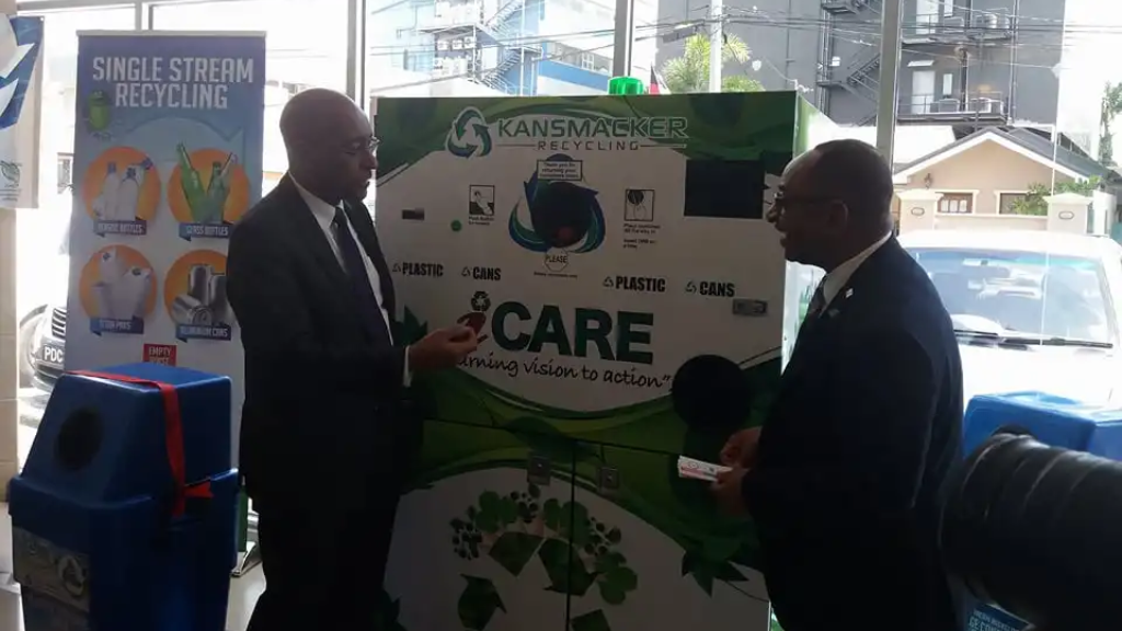 Caption: Minister of Public Utilities Robert Le Hunte and Hayden Romano, Managing Directer of the Emergency Management Authority (EMA) during Tuesday's launch of the Public Sector Recycling Programme.