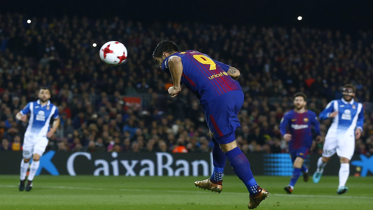Barcelona's Luis Suarez, center, heads the ball to score during the Spanish Copa del Rey, quarter final, second leg, football match against Espanyol at the Camp Nou stadium in Barcelona, Spain, Thursday, Jan. 25, 2018.