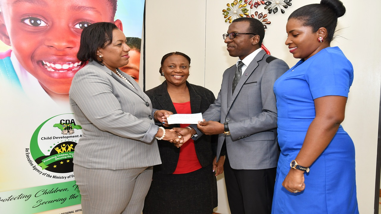 Calvin A. Hunter, District Governor, Optimist International Caribbean District (second right) presents a cheque for $100,000 to Rosalee Gage-Grey (left), Chief Executive Officer of the Child Protection and Family Services Agency (CPFSA), while Audrey Budhi (second left), Director of Children and Family Programmes at CPFSA and Carlene A. Hunter (right), District Secretary, Optimist International Caribbean District look on.