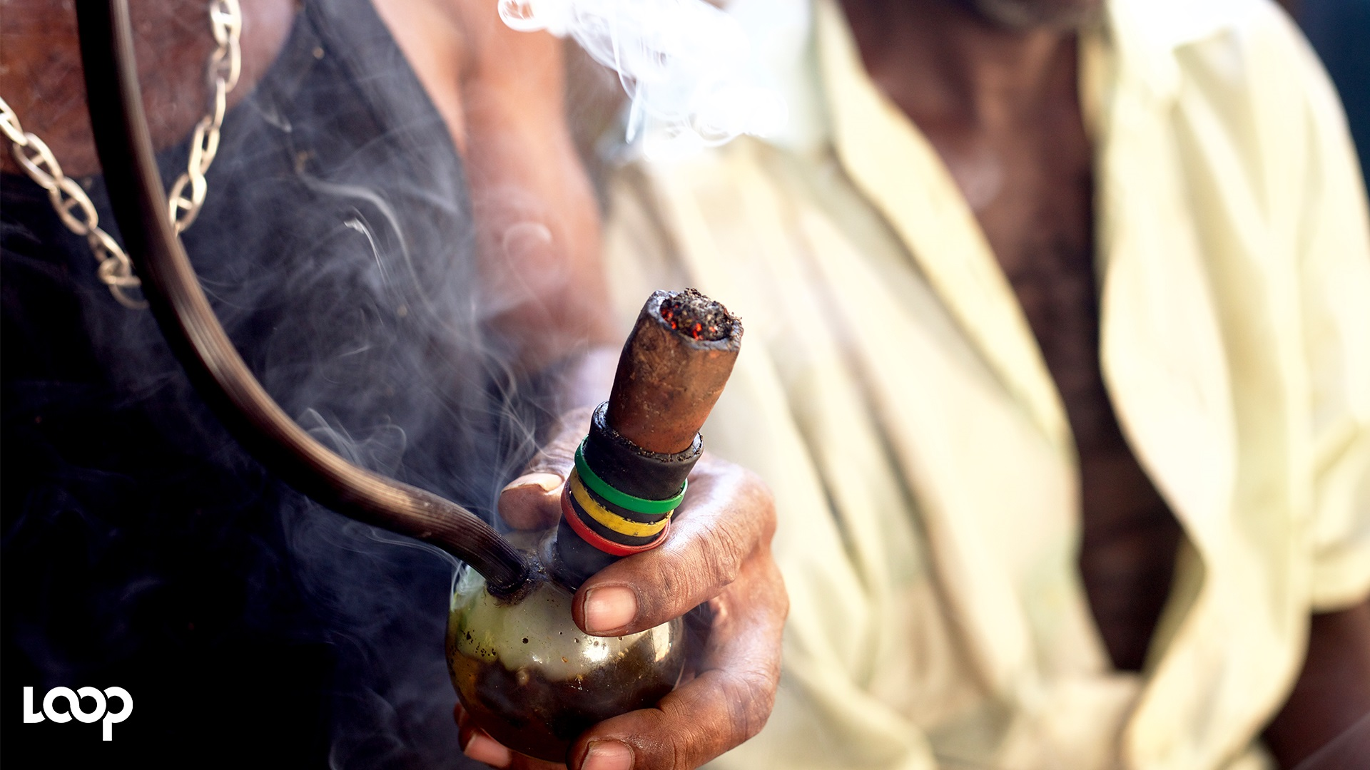 A man smokes ganja with a chalice. (PHOTO: Shawn Barnes)