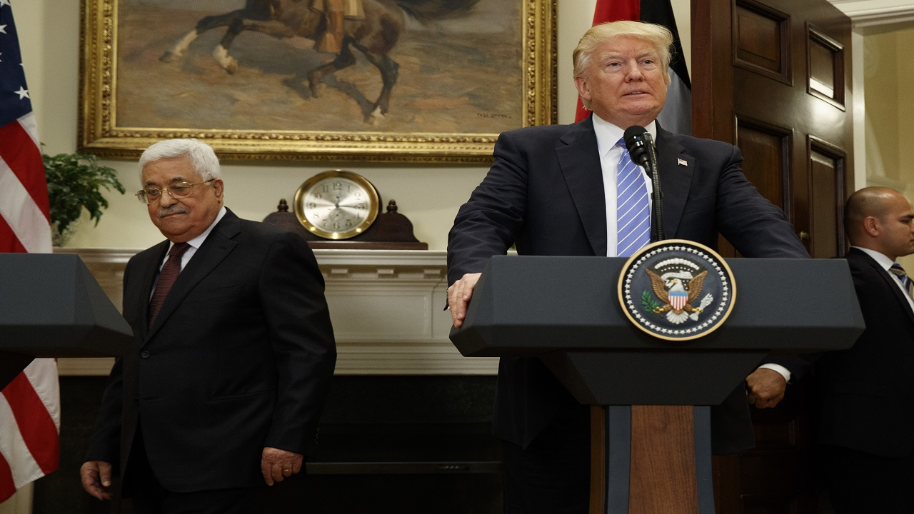In this May 3, 2017 file photo, President Donald Trump and Palestinian Authority President Mahmoud Abbas arrive in the Roosevelt Room of the White House in Washington.