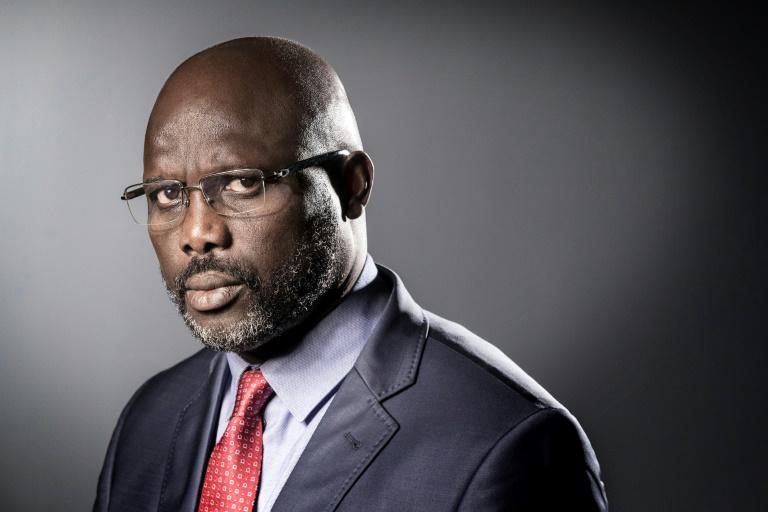 George Manneh Oppong Ousman Weah, ancien Ballon d'or élu président de la République du Libéria le 26 décembre 2017.