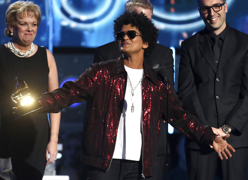 "Bruno Mars accepts the award for record of the year for ""24K Magic"" at the 60th annual Grammy Awards at Madison Square Garden on Sunday, in New York. (Photo by Matt Sayles/Invision/AP)"