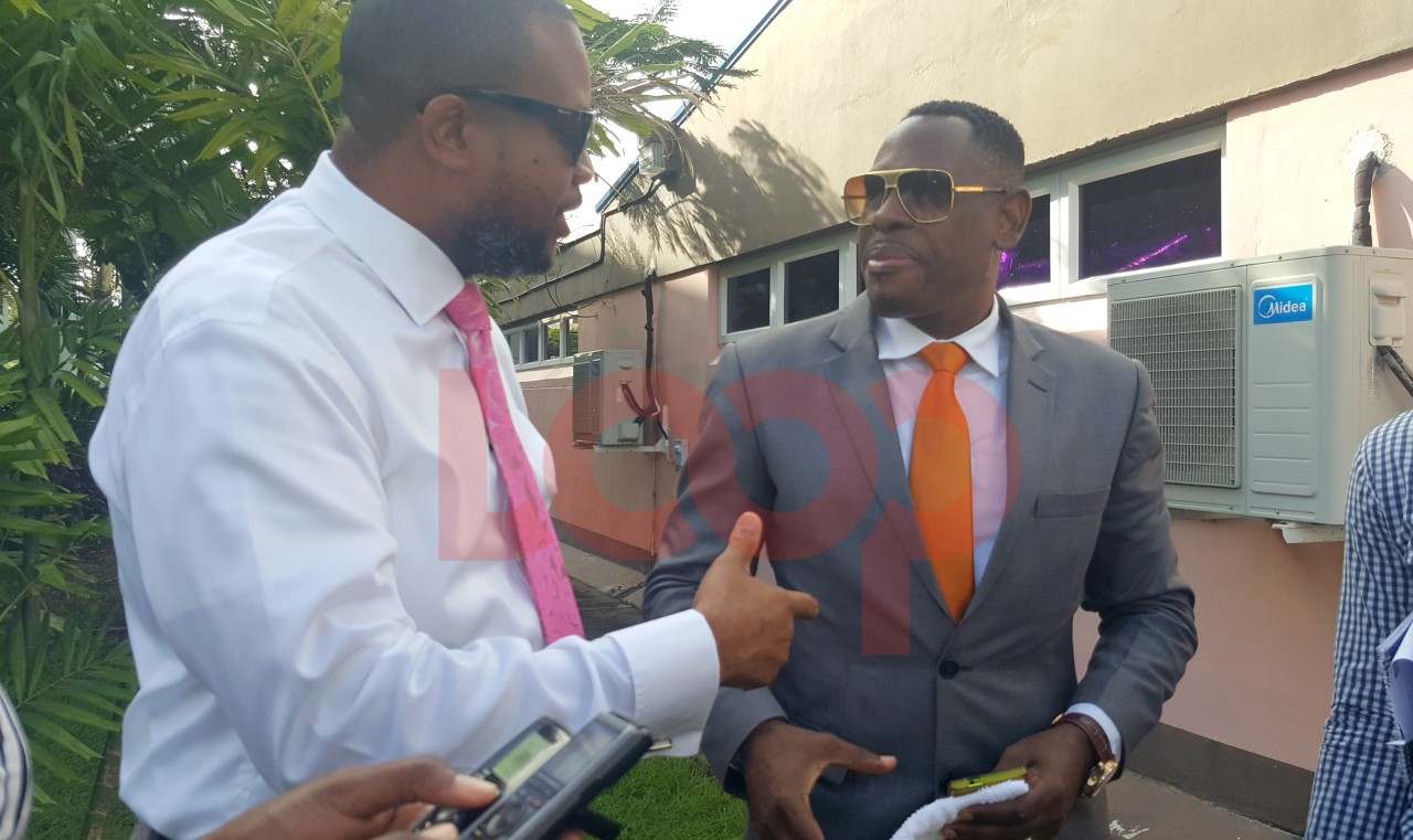 (L-R) Barbados Integrity Movement Chairman Neil Holder and Apostle Lynroy Scantlebury of the New Barbados Kingdom Alliance