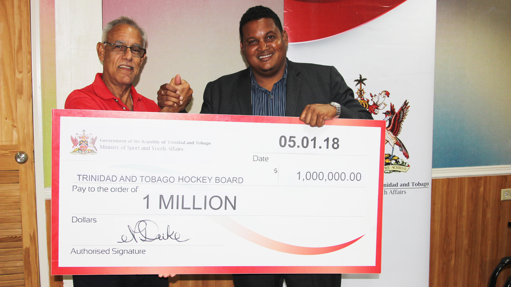 Darryl Smith, Minister of Sport and Youth Affairs, presented Douglas Camacho, President of the Trinidad and Tobago Hockey Board with a cheque valued at $1 million on January 5 at the TTOC's Head Office.