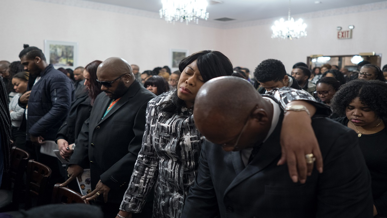 Family members and other mourners attend a service for fire victims Holt Francis; his wife, Karen Stewart-Francis, 37; their daughters, Kylie, 2, and Kelesha, 7; and their cousin, Shawntay Young, 19, Monday, Jan. 8, 2018, in New York. The family members died in a fatal fire in the Bronx borough of New York that took over a dozen lives on Dec. 28, 2017. (AP Photo/Craig Ruttle)