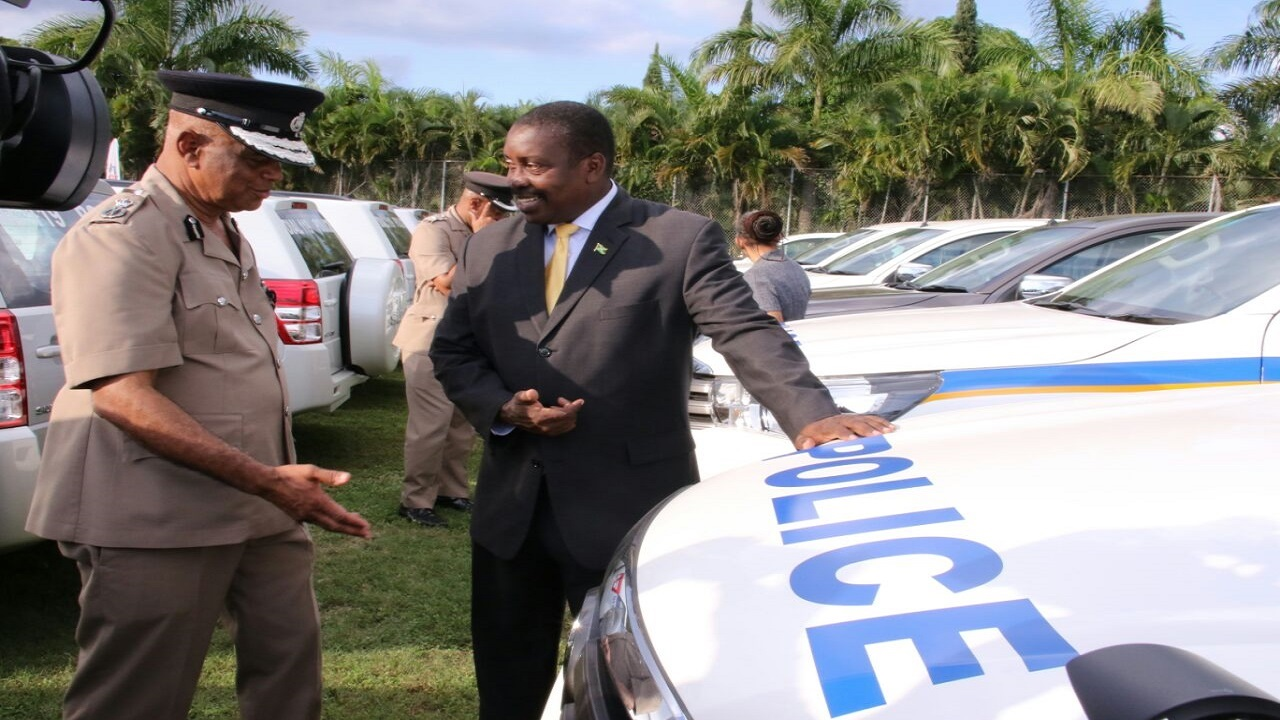 Police Commissioner, George Quallo (left) and National Security Minister, Robert Montague, at the recent presentation of a batch of pre-owned vehicles to the constabulary force.