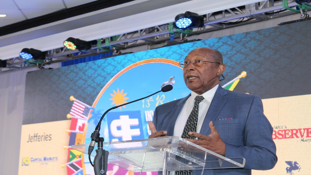 Dr Henry Lowe addresses the audience at the Jamaica Stock Exchange's 13th Regional Investments and Capital Markets Conference on Wednesday. (PHOTO: Shamille Scott)