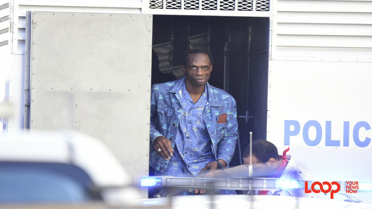 Ninjaman exiting a police truck at the Supreme Court in downtown Kingston during his murder trial late last year, which resulted in a life sentence for the dancehall artiste.