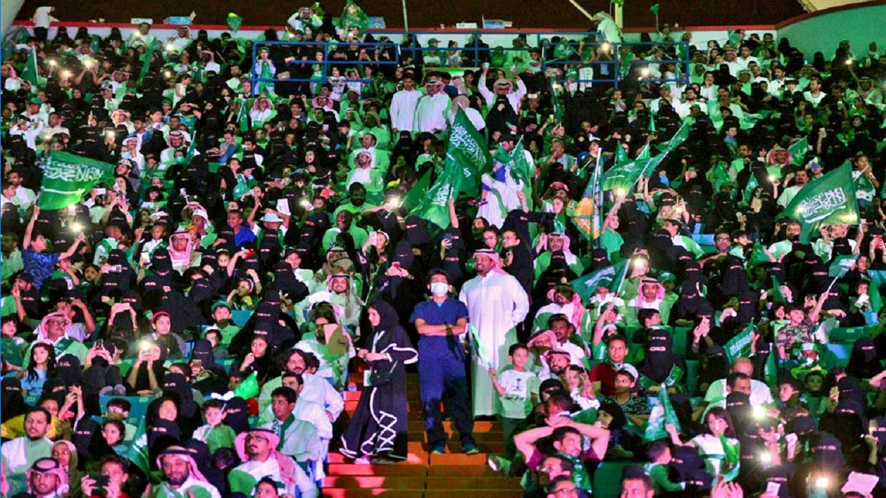 In this Sept. 23, 2017 file photo released by Saudi Press Agency, SPA, Saudi men and women attend national day ceremonies at the King Fahd stadium in Riyadh, Saudi Arabia. Saudi women will for the first time be allowed to enter a sports stadium on Friday, Jan. 12, 2018, to watch a football match between two local teams.