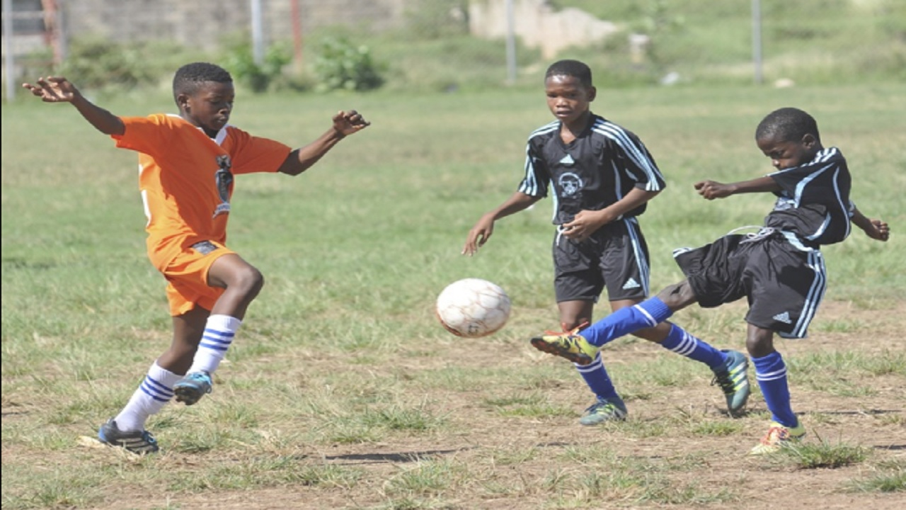 Zaire Doose (right) of Holy Family shoots at goal during the final of the INSPORTS/ Kingston Primary School football competition against Denham Town at the Boys' Town field on Thursday, January 11, 2018.