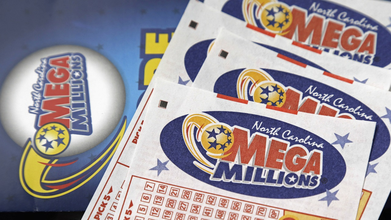 In this July 1, 2016, file photo, Mega Millions lottery tickets rest on a counter at a Pilot travel center near Burlington, N.C. One Mega Millions ticket matched all six numbers on Friday, January 5 and will claim a $450 million grand prize.