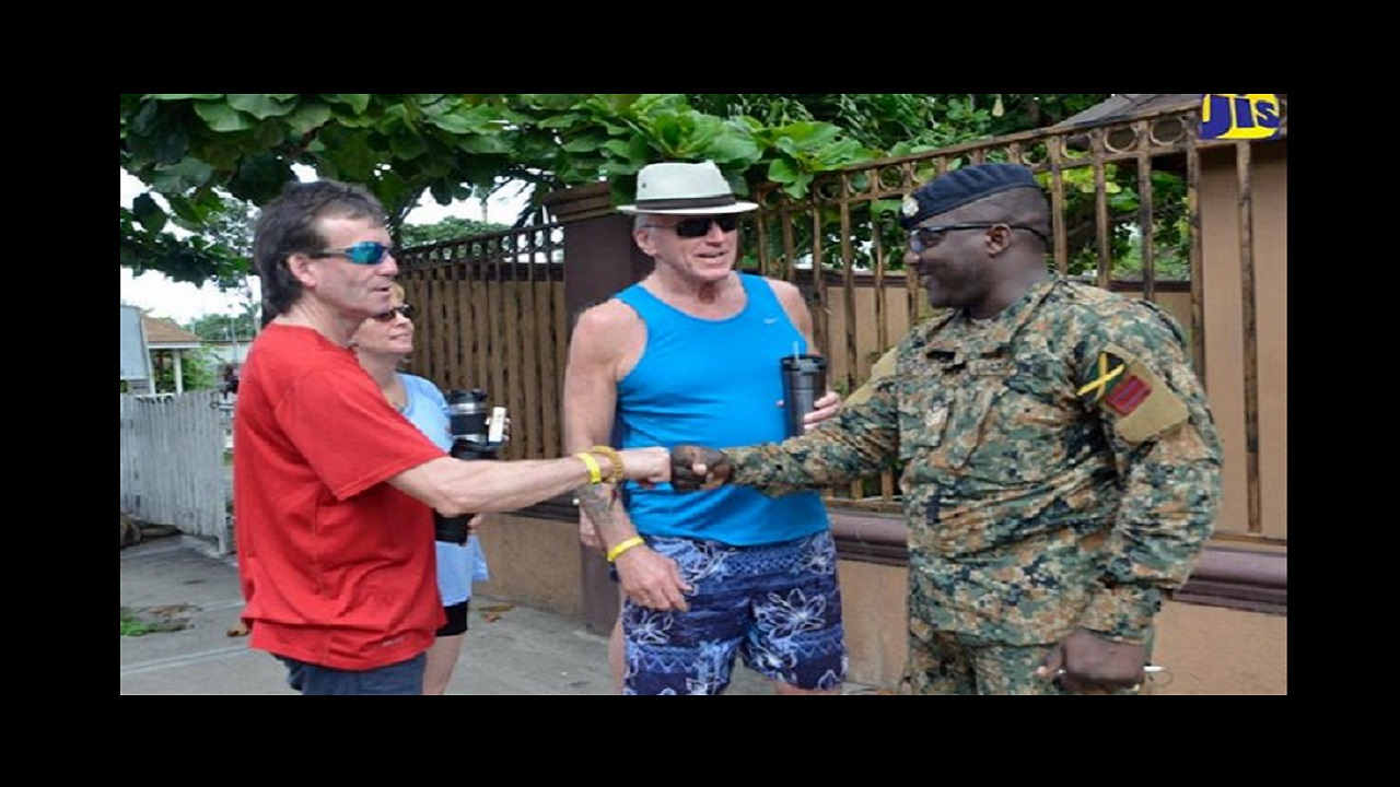 Canadian visitors greet and engage in conversation with a Jamaica Defence Force (JDF) soldier, who was on Gloucester Avenue in Montego Bay, St. James, on Friday. Photo via Jamaica Information Service.