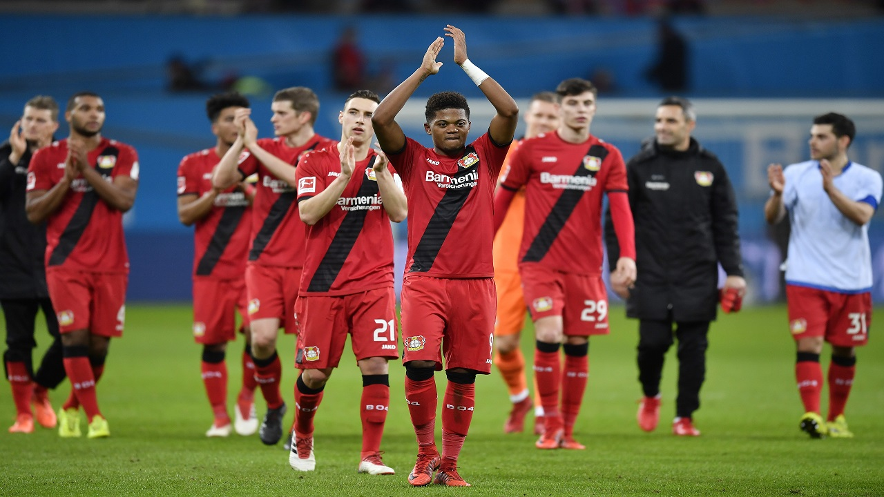 Leverkusen's Leon Bailey, center, celebrates with team and supporters after the German Bundesliga football match between Bayer Leverkusen and FSV Mainz in Leverkusen, Germany, Sunday, Jan. 28, 2018. Leverkusen defeated Mainz 2-0. (AP Photo/Martin Meissner)