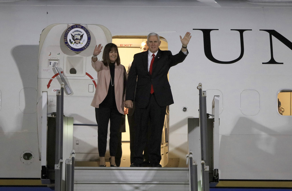 U.S. Vice President Mike Pence and his wife Karen disembark the plane upon his arrival at Amman military airport in Jordan. (AP Photo/Raad Adayleh)