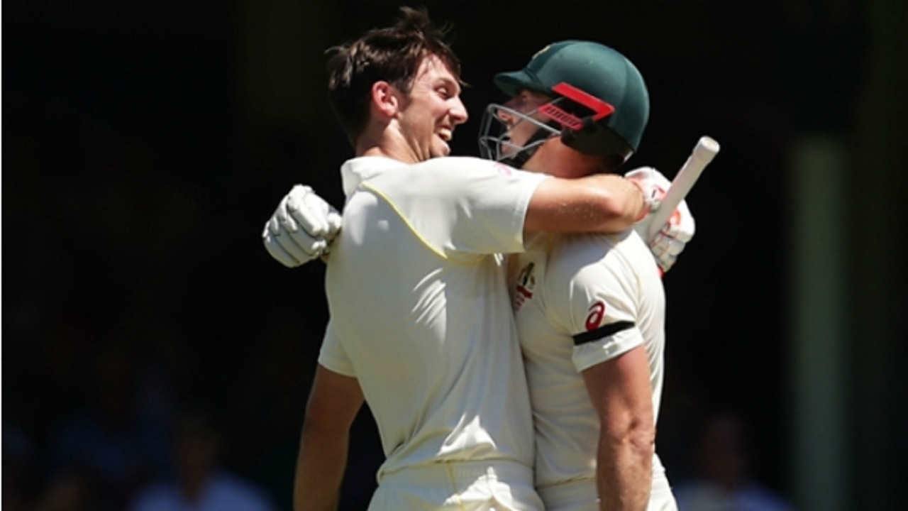 Brothers Shaun and Mitchell Marsh of Australia celebrate centuries in the fifth Ashes Test against England in Sydney.