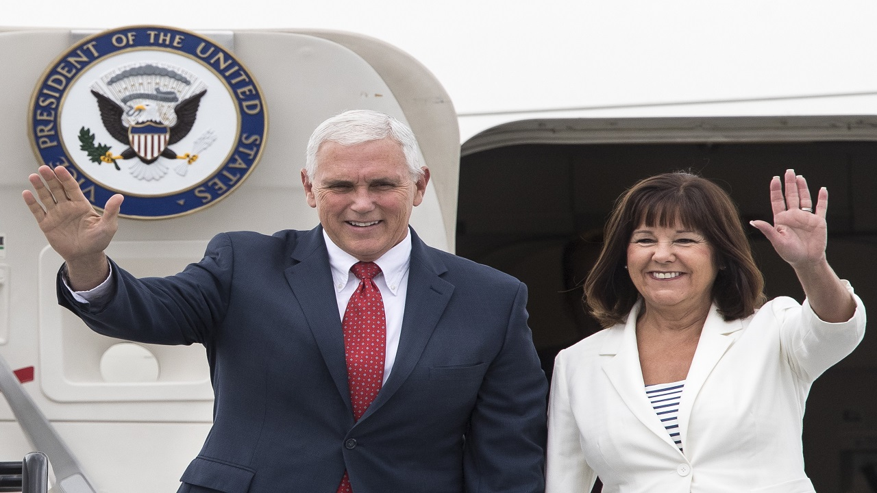 In this July 30, 2017, file photo, U.S. Vice President Mike Pence and his wife, Karen, wave as they arrive at the airport in Tallinn, Estonia. Vice President Mike Pence and Karen Pence will lead the U.S. delegation to the 2018 Winter Olympics in South Korea.