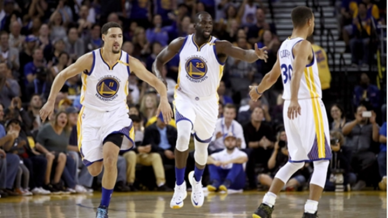 Golden State Warriors players (from left) Klay Thompson, Draymond Green and Stephen Curry.