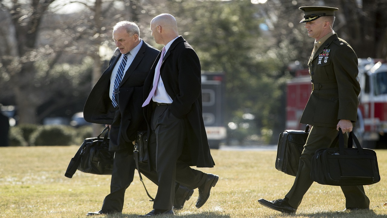 President Donald Trump's Chief of Staff John Kelly, left, and White House Director of Legislative Affairs Marc Short, second from left, walk toward Marine One on the South Lawn of the White House in Washington, Friday, Jan. 5, 2018, to travel with President Donald Trump to Camp David in Maryland.