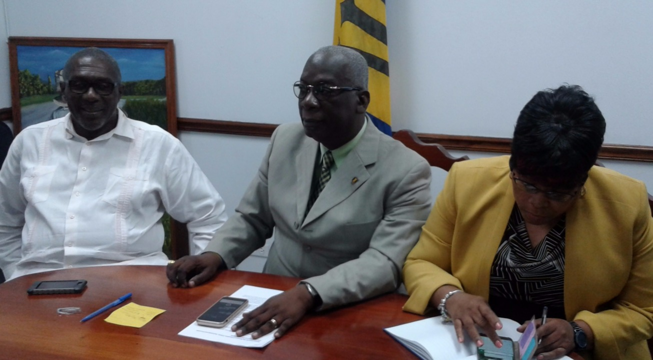 (L-R) Parliamentary Secretary in the Ministry of Education, Senator Harry Husbands, Minister Ronald Jones and Chief Education Officer, Karen Best.