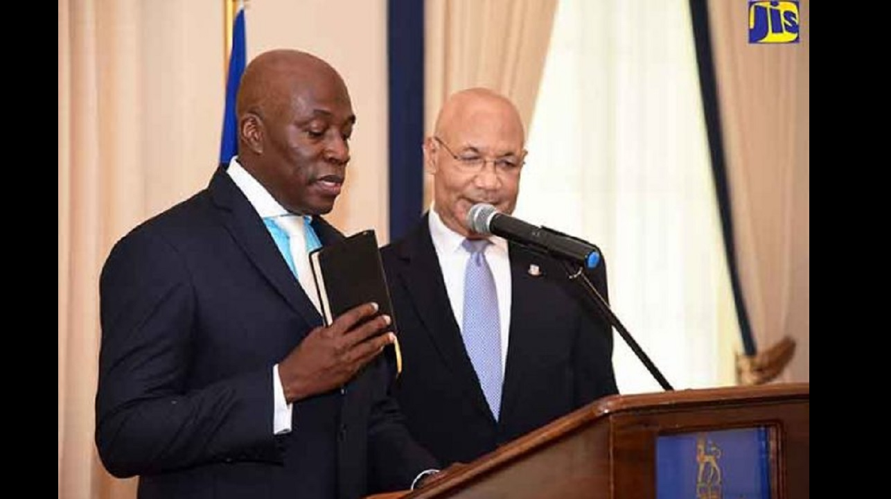 Justice Bryan Sykes takes the Oath of Office during a ceremony at King's House on February 1, after being appointed to act as Chief Justice. Governor General Sir Patrick Allen looks on. (PHOTO: JIS)