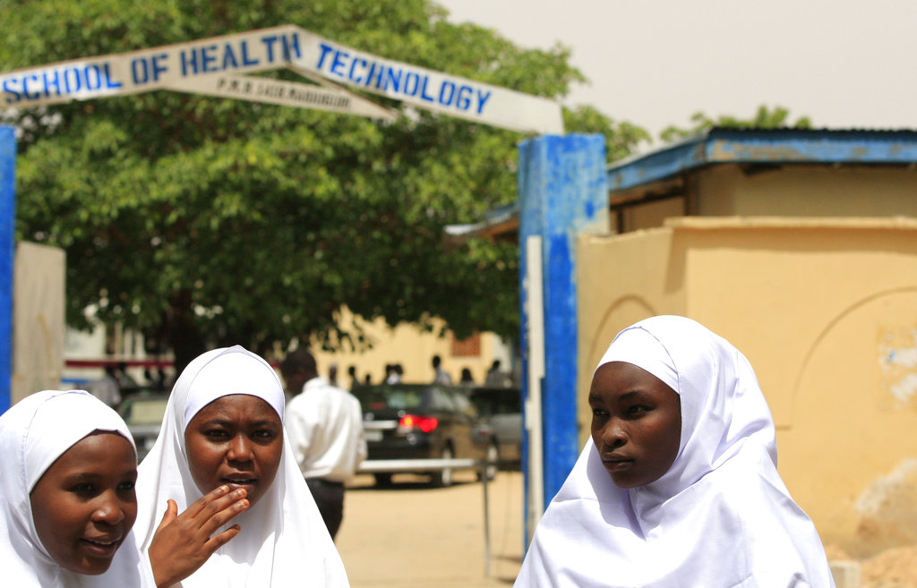 Young women stand in front of a school in Maiduguri, Nigeria. (AP Photo/Jon Gambrell, File)