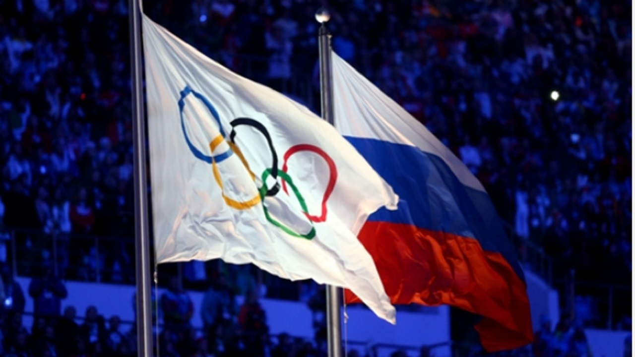 The Olympic flag and Russian flag.