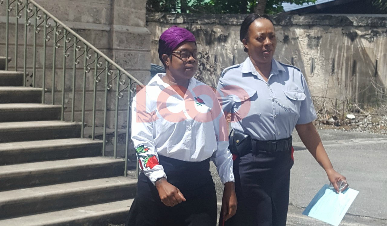 Hazel Greenidge in police custody.