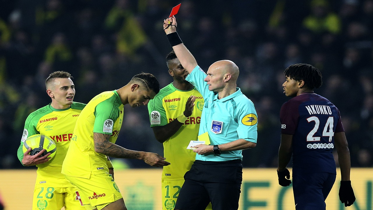 French referee banned for three months after kicking out at player