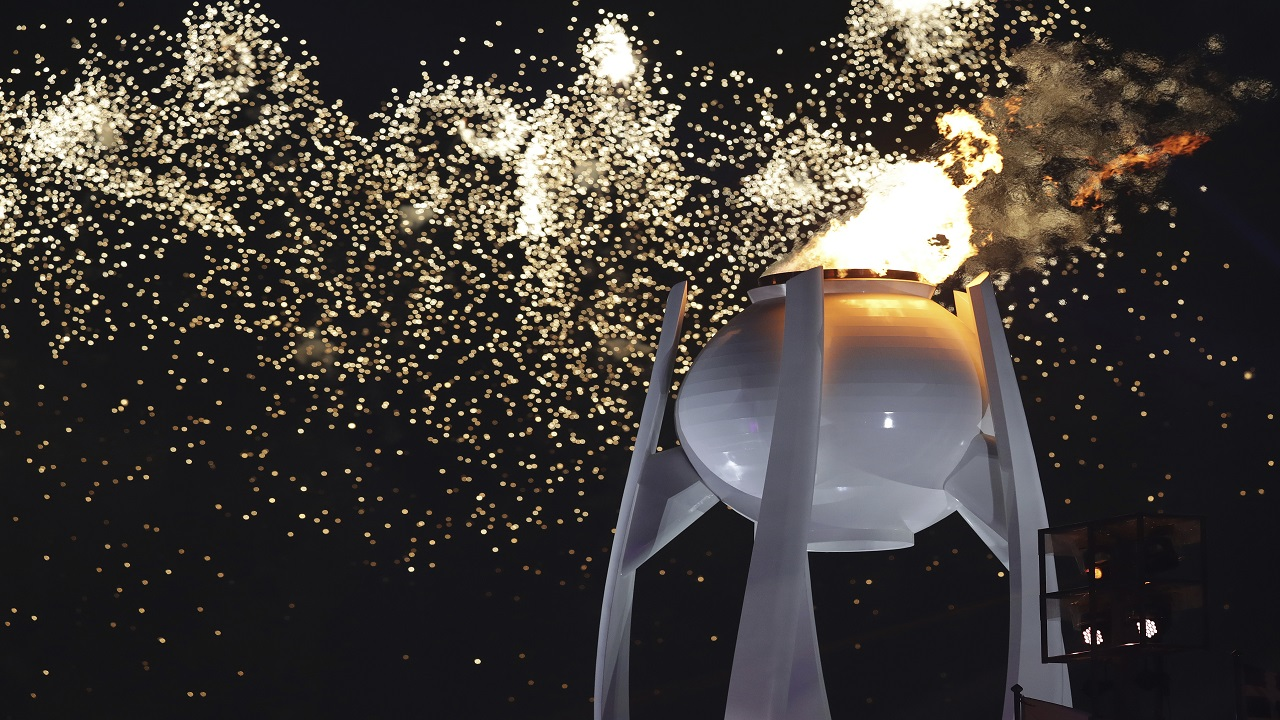Fireworks explode over the Olympic flame during the opening ceremony of the 2018 Winter Olympics in Pyeongchang, South Korea, Friday, Feb. 9, 2018.