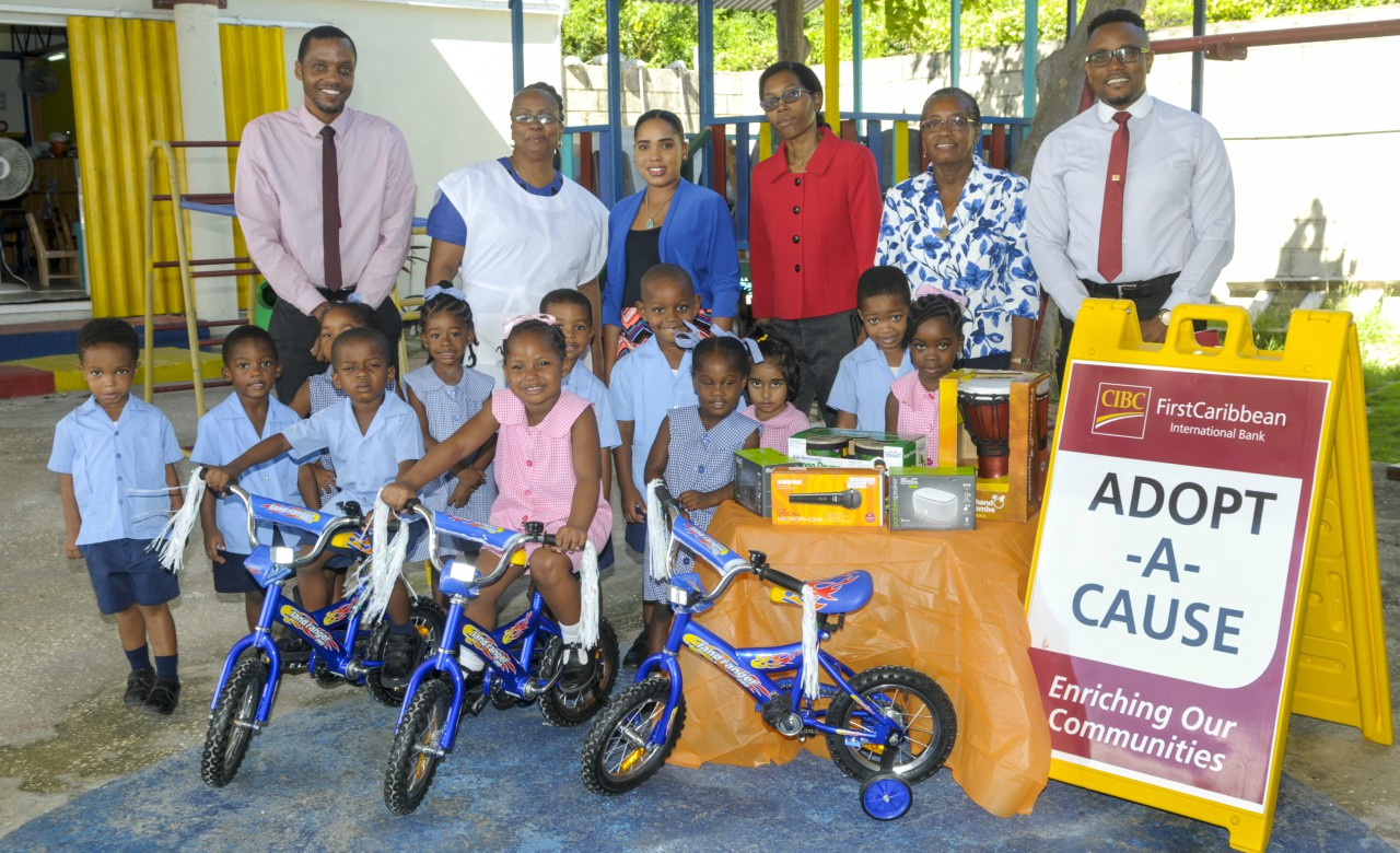 (L-R) Mr. Carlos Moore - Manager, Sales, Cash Management & Merchant Services – Barbados; Mrs. Ifill - Ancillary Staff, Eden Lodge Nursery School; Ms. Harewood - Teacher, Eden Lodge Nursery School; Mrs. Wynsome Williams - Senior Teacher, Eden Lodge Nursery School; Mrs. Rose-Claire Blades - Principal, Eden Lodge Nursery School and Mr. Kerry Jordan - Manager, Trade Finance with students of the Eden Lodge Nursery School