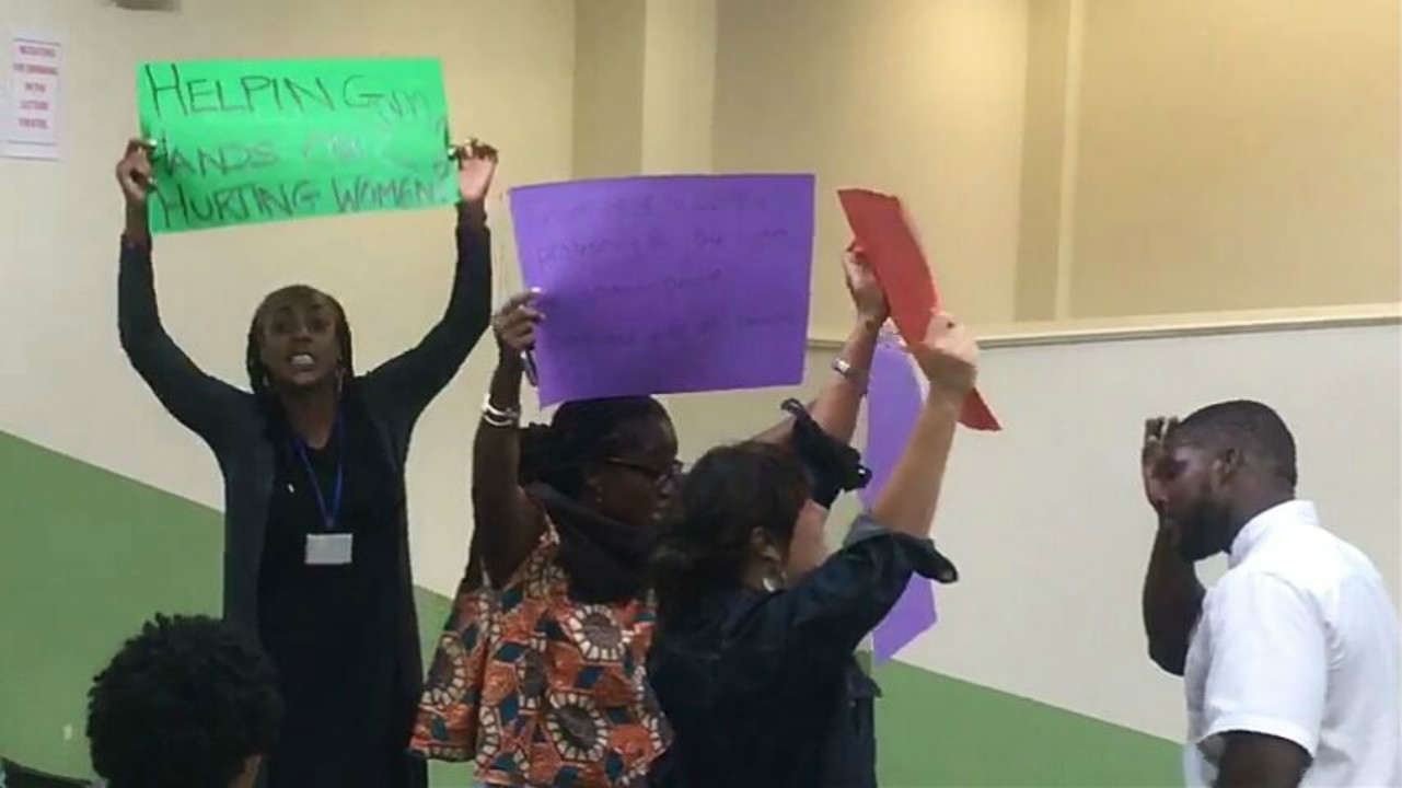 Group of women demonstrating during the public lecture delivered by SVG Prime Minister, Ralph Gonsalves.