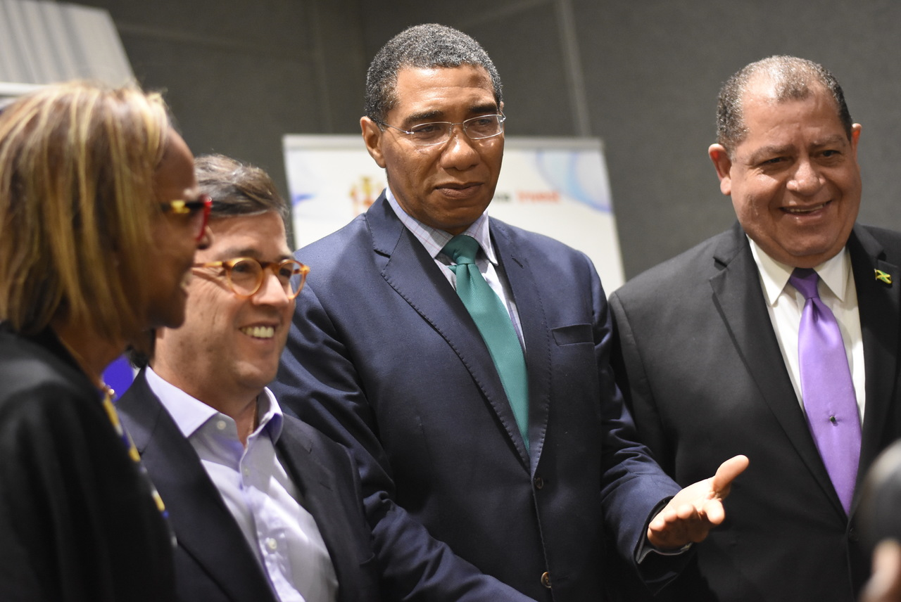 Prime Minister Andrew Holness (centre) at the IDB Governors Meeting with IDB President Luis Moreno (second left), Finance Minister Audley Shaw (right) and General Manager, Caribbean Country Department at IDB,  Therese Turner-Jones (partially hidden) . Photo: Marlon Reid