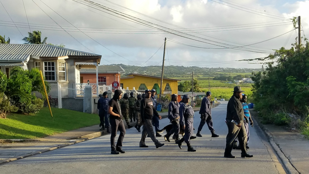 Members of the Royal Barbados Police Force and the Barbados Defence Force searched for Daquan Dashon Anderson St. Hill yesterday.