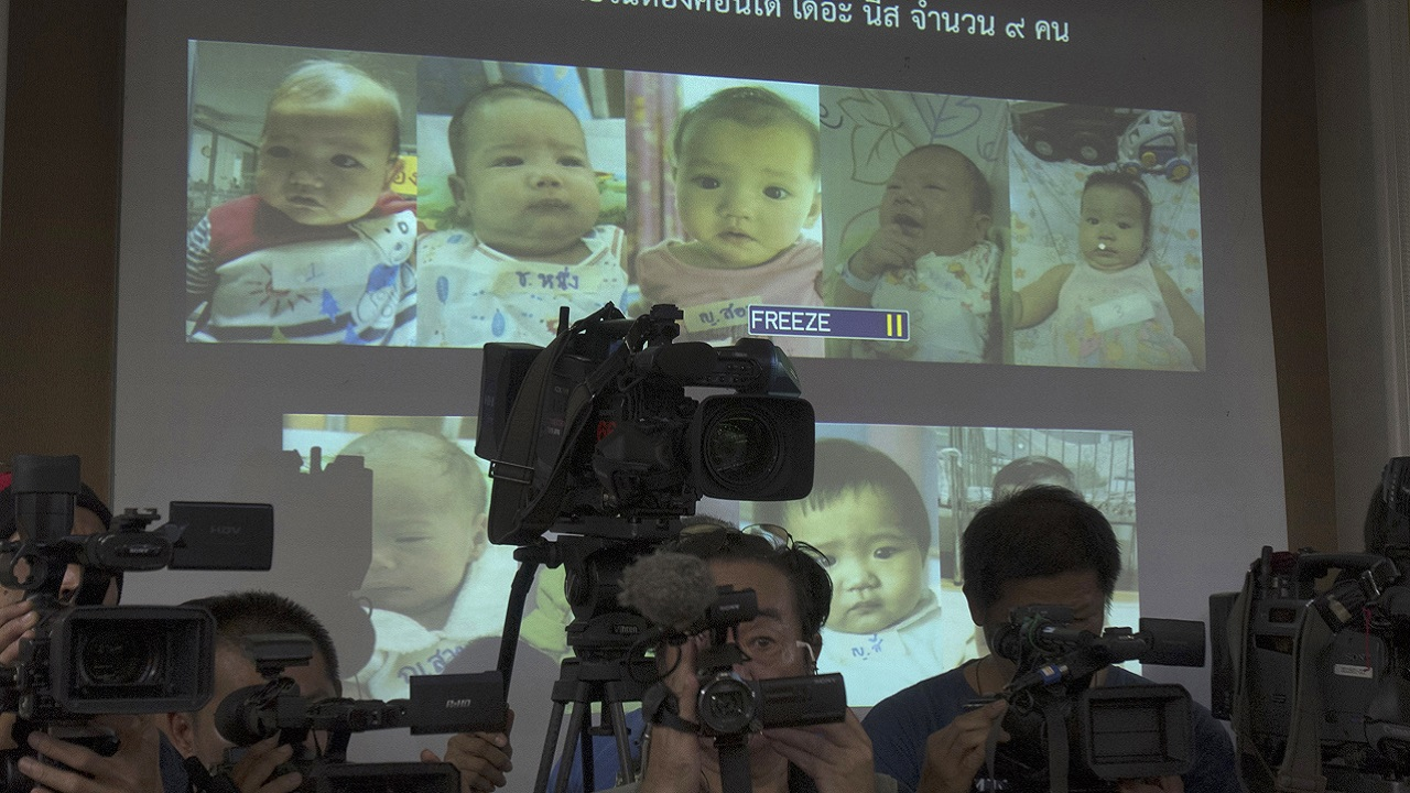 (Image: AP: Press briefing in Thailand on 12 August 2014 regarding the surrogate babies)
