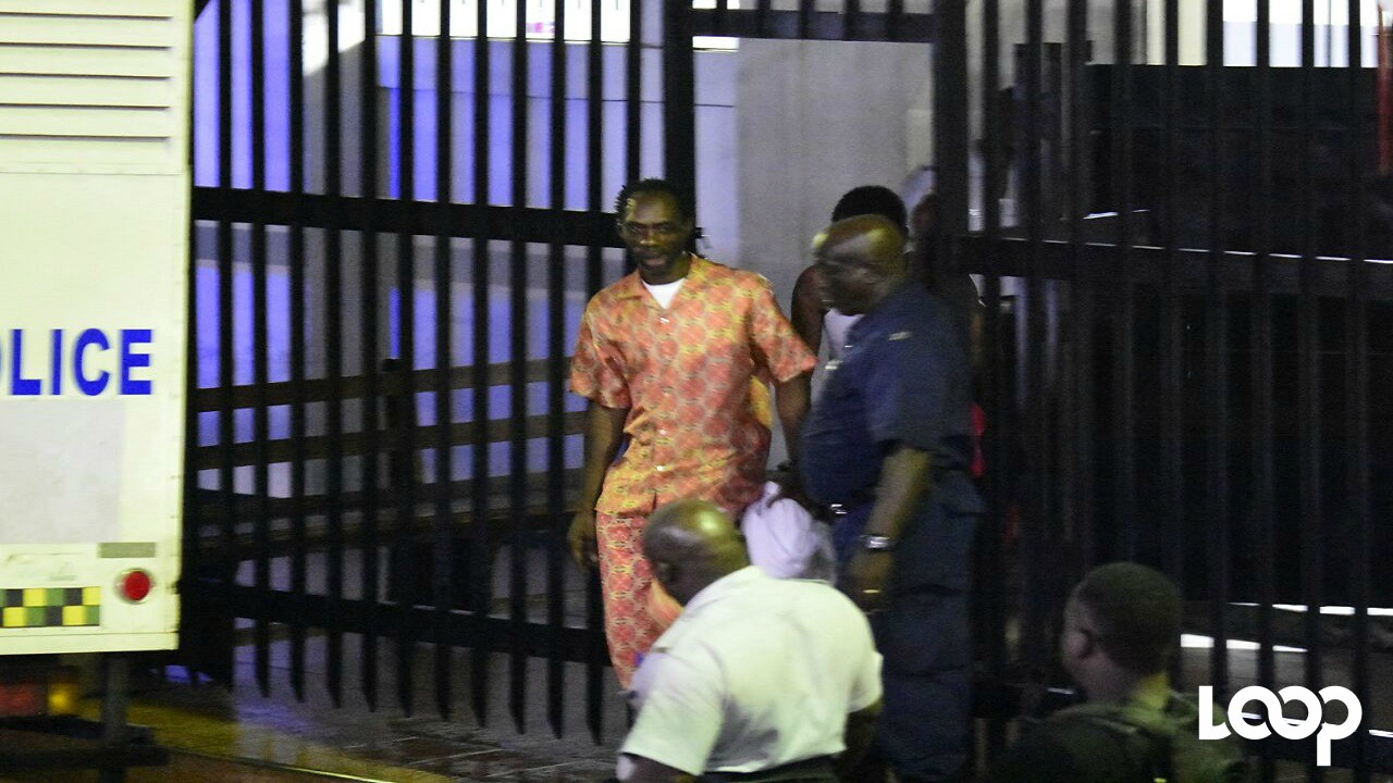 Dancehall artiste Ninjaman being escorted from court following the verdict in the murder trial last month.