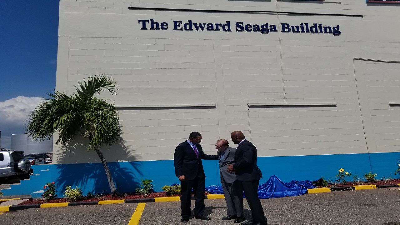 Prime Minister Andrew Holness (left); former Prime Minister, Edward Seaga (centre); and Minister of Science, Energy and Technology, Dr Andrew Wheatley, in discussion after the unveiling of 'The Edward Seaga Building' sign at the corporate office of Petrojam Limited located on Marcus Garvey Drive in Kingston on Thursday.
