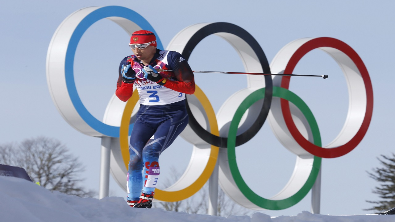In this Feb. 23, 2014 file photo Russia's gold medal winner Alexander Legkov skis past the Olympic rings during the men's 50K cross-country race at the 2014 Winter Olympics in Krasnaya Polyana, Russia. The Court of Arbitration for Sport ruled on Thursday, Feb. 1, 2018 to reinstate Leskov as gold medal winner of the men's 50-kilometer cross-country skiing which he was stripped of on doping allegations earlier.