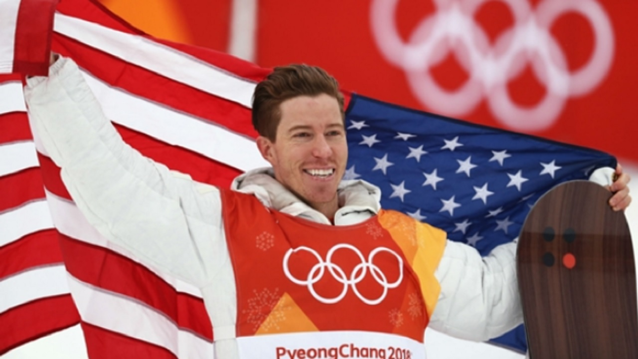 Shaun White celebrates his third Olympic gold medal.