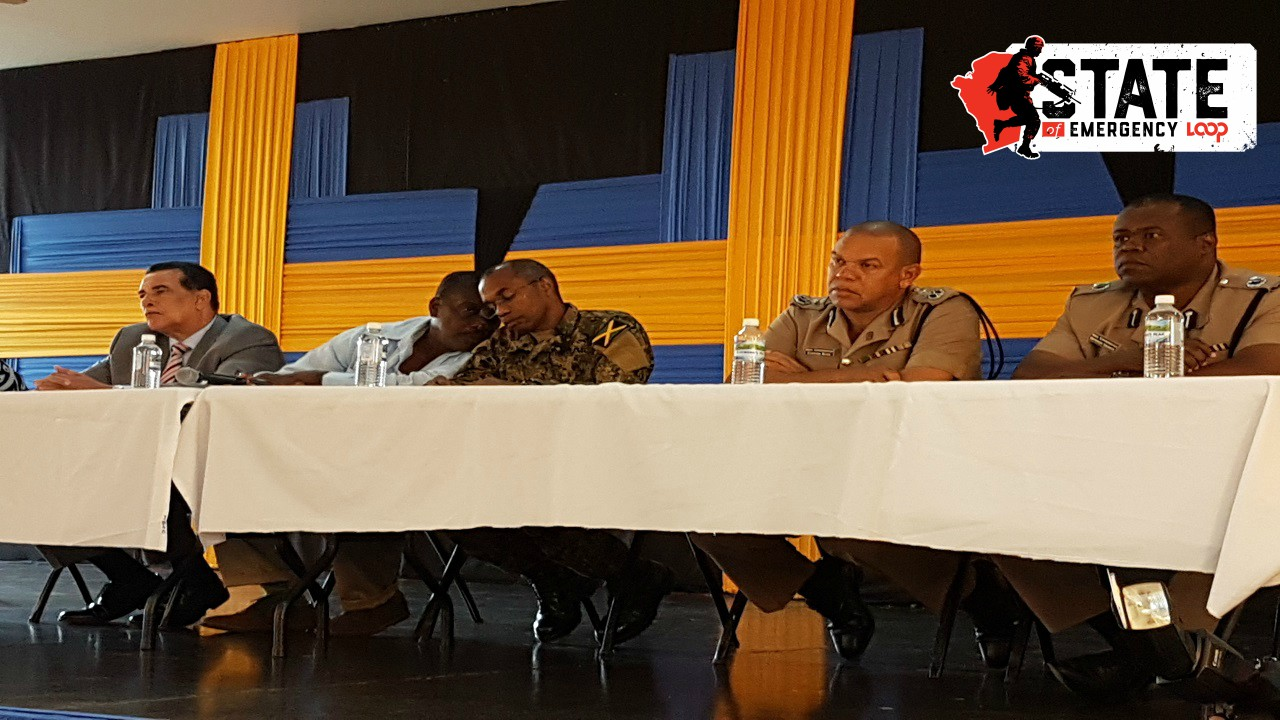 National Security Minister Robert Montague (second left) in discussion with Major General Rocky Meade (centre) while (from left) Montego Bay Mayor Homer Davis and acting police commissioner Clifford Blake look on.