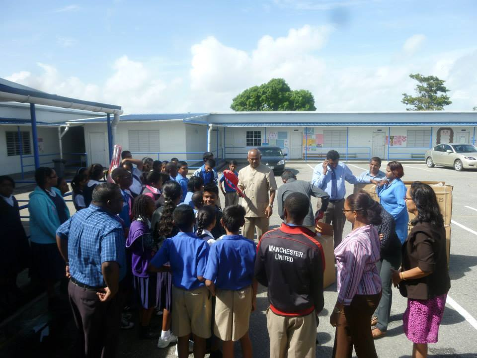 In this photo dated 2015, Couva South MP Rudy Indarsingh speaks to students of Balmain Presbyterian School.