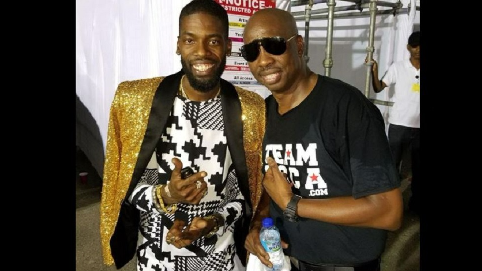 (Photo: Iwer George poses with Sunny Bling at Machel Monday. Iwer called Sunny onstage to perform his parody 'Doubles and Channa' but was stopped from doing so by Montano.