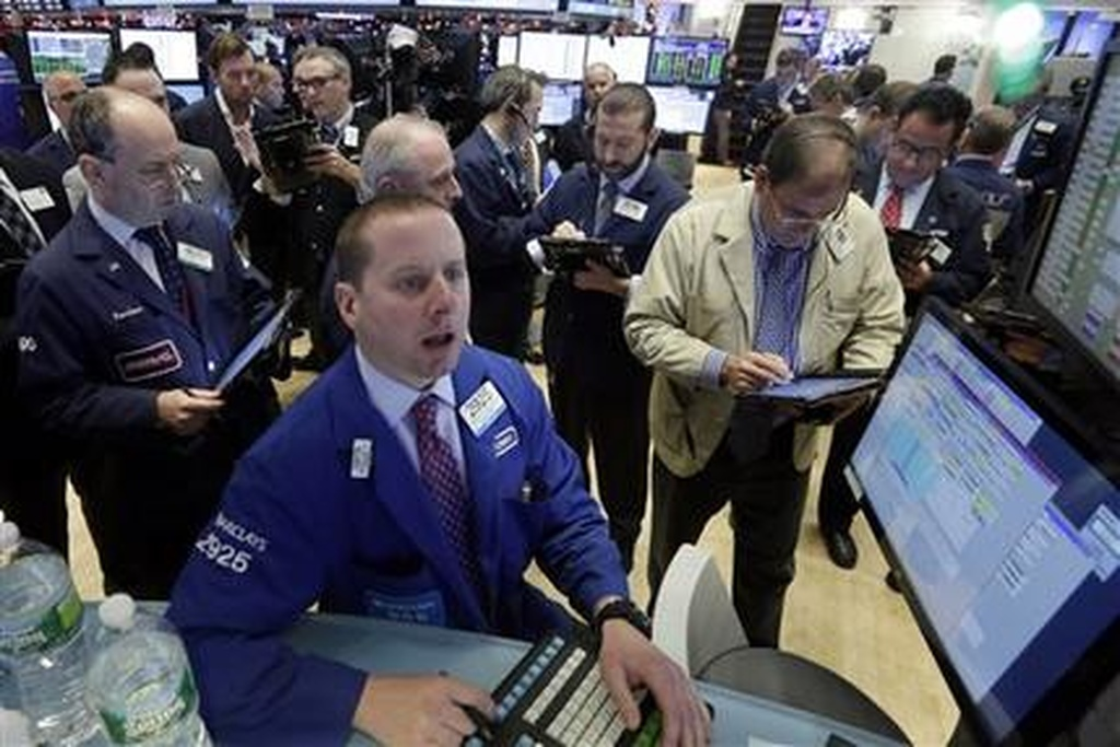 Wall Street gains as volatility eases, Dow up over 200 points