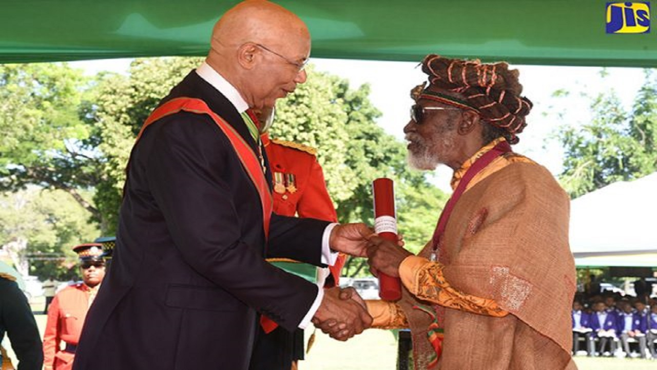 Neville O'Reilly Livingstone, popularly known as 'Bunny Wailer', receiving the Order of Merit from Governor General, Sir Patrick Allen, at King's House last October.