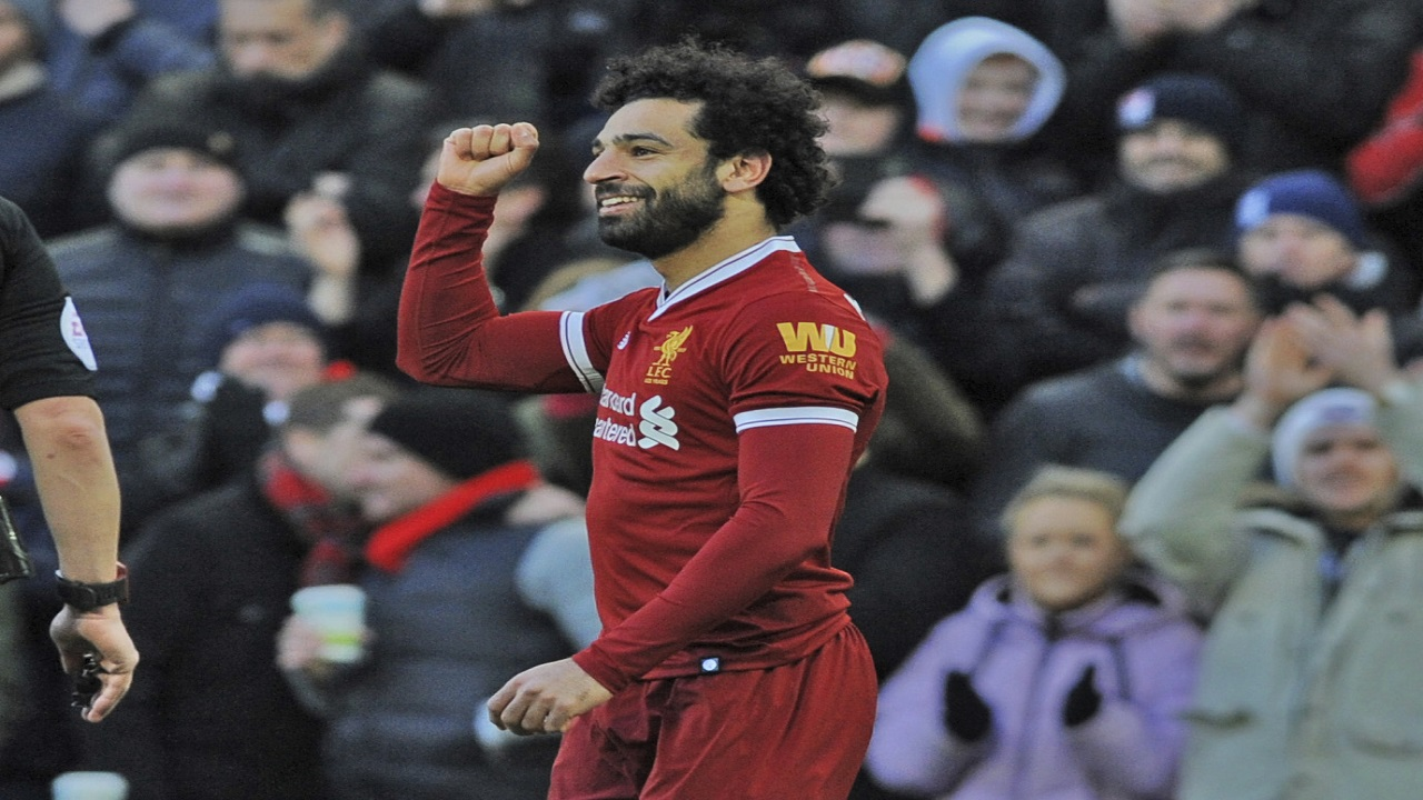 Liverpool's Mohamed Salah celebrates scoring his side's second goal of the game against West Ham, during their English Premier League football match at Anfield in Liverpool, England, Saturday, Feb. 24, 2018.