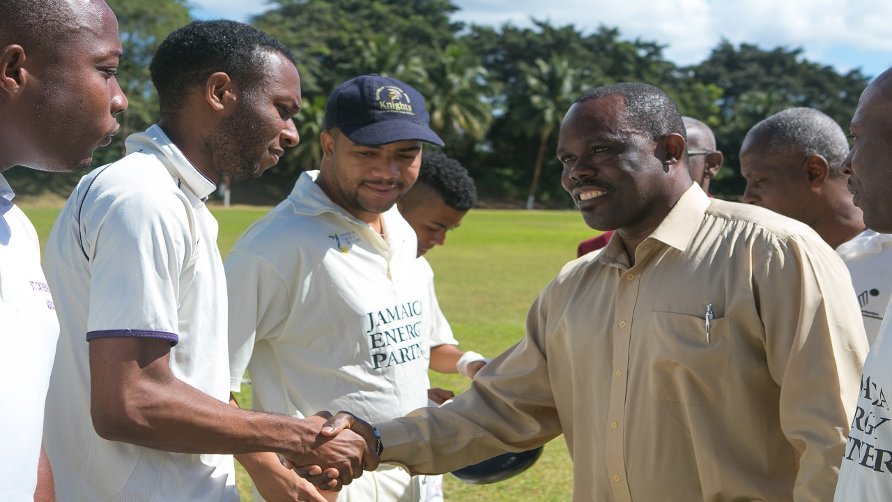 Cecil Gordon, JEP's Chief Technical Officer, greets players before the match at the launch of JEP's Cricket League for 2018.